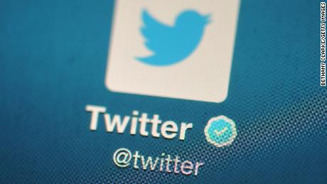 In this photo illustration, The Twitter logo is displayed on a mobile device as the company announced it's initial public offering and debut on the New York Stock Exchange on November 7, 2013 in London, England.