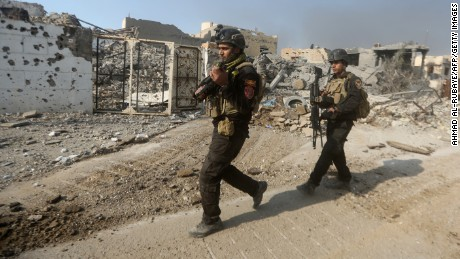 Members of Iraq's elite counter-terrorism service patrol on December 29, 2015 the city of Ramadi, the capital of Iraq's Anbar province, about 110 kilometers west of Baghdad, after Iraqi forces recaptured it from the Islamic State (IS) jihadist group. Iraq declared the city of Ramadi liberated from the Islamic State group Monday and raised the national flag over its government complex after clinching a landmark victory against the jihadists. AFP PHOTO / AHMAD AL-RUBAYE / AFP / AHMAD AL-RUBAYE        (Photo credit should read AHMAD AL-RUBAYE/AFP/Getty Images)