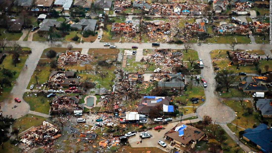 "An aerial image taken Sunday, December 27, shows the path of a tornado near Freeport Drive in Garland, Texas. The National Weather Service confirmed that <a href=""http://www.cnn.com/2015/12/27/us/gallery/texas-tornadoes/index.html"" target=""_blank"">three tornadoes</a> were part of storms that ripped through the Dallas area, killing 11 people and damaging hundreds of buildings."