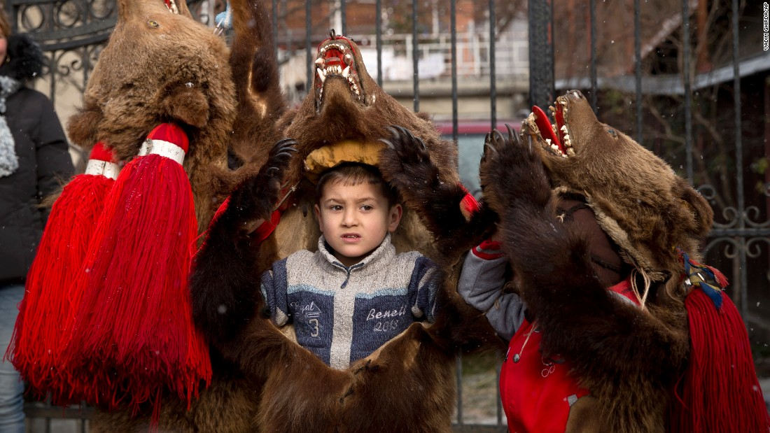 "Children wearing bearskins perform at a New Year's festival in Comanesti, Romania, on Wednesday, December 30. In that region,<a href=""http://www.cnn.com/2015/11/01/travel/cnnphotos-bear-dance/"" target=""_blank""> traditional ""bear dancing""</a> is meant to drive away evil spirits."
