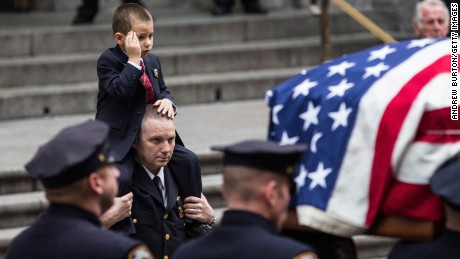 Joseph Lemm's son, Ryan, salutes at his father's funeral.