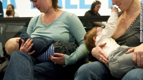 "Women breastfeed their babies at the Hirshhorn Museum in Washington on February 12, 2011 during a ""nurse-in""organized after a woman was stopped from nursing in public at the museum by security guards two weeks ago."