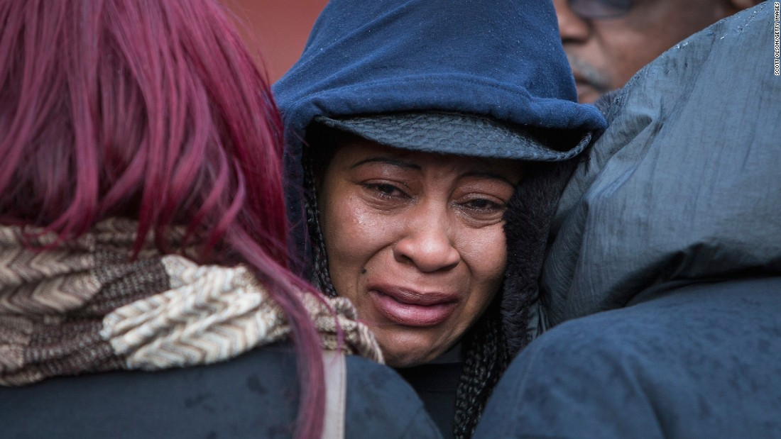 "Janet Cooksey is comforted as she listens to speakers talk about the death of her son, Quintonio LeGrier, before the start of a vigil in Chicago on Sunday, December 27. LeGrier, 19, <a href=""http://www.cnn.com/2015/12/28/us/chicago-police-shooting/"" target=""_blank"">was fatally shot at his home</a> by police responding to a domestic dispute call made by his father. Neighbor Bettie Jones, 55, was also killed by police during the incident. Jones shouldn't have been shot, police say. She was ""accidentally struck and tragically killed"" by an officer."