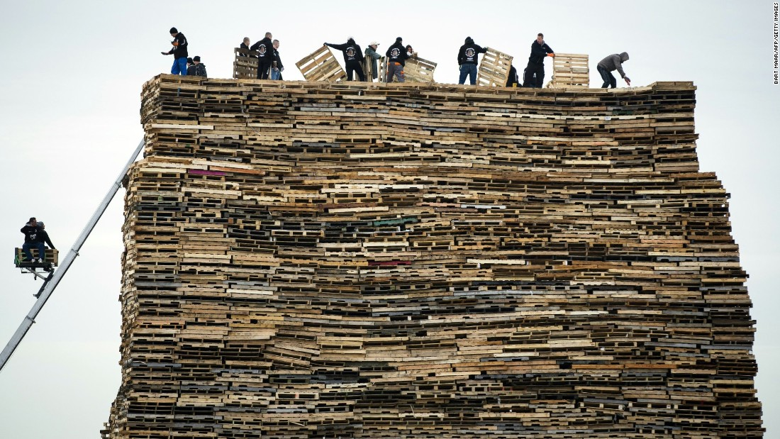 People pile up wooden pallets Tuesday, December 29, for a traditional New Year's Eve bonfire in Scheveningen, a district of The Hague in the Netherlands.