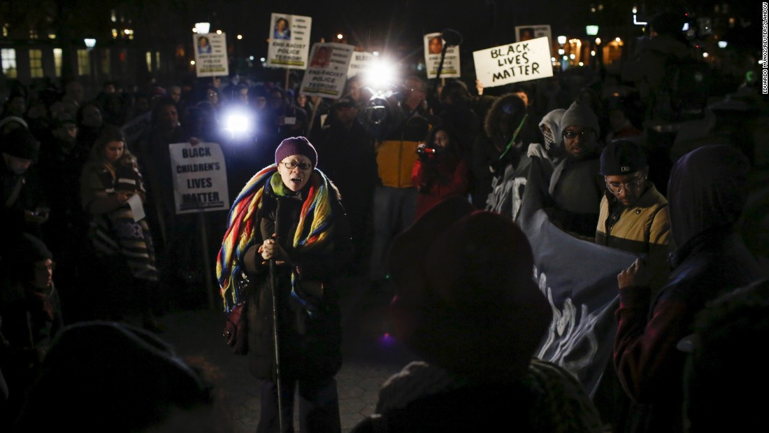 "People in New York City protest against the police Monday, December 28, after a grand jury <a href=""http://www.cnn.com/2015/12/28/us/tamir-rice-shooting/"" target=""_blank"">cleared two Cleveland police officers</a> in the 2014 shooting of 12-year-old Tamir Rice. Tamir was carrying a toy gun that police officers said looked like a real gun at the time."