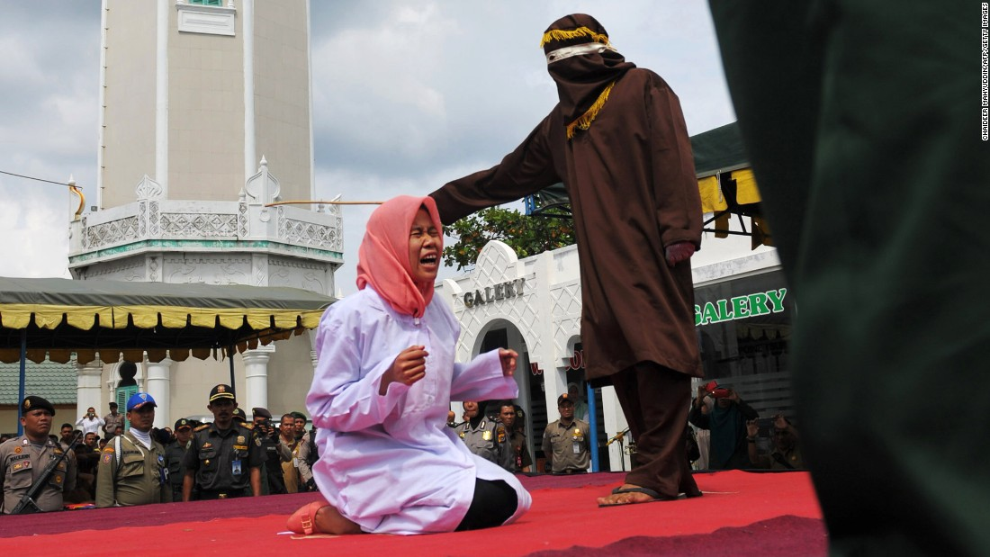 "A young woman is <a href=""http://www.cnn.com/2015/12/30/asia/indonesia-caning/"" target=""_blank"">caned in public,</a> a punishment under Sharia law, for being seen alone with a man who was not her spouse Monday, December 28, in Banda Aceh, Indonesia. The man was also caned. Aceh is the only province of Indonesia enforcing the strict form of Islamic law."