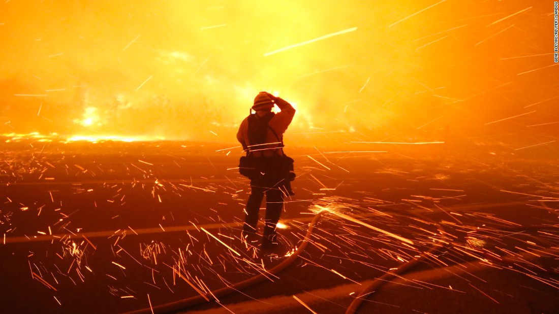 "Fire photographer Tod Sudmeier gets hit with flying embers at <a href=""http://www.cnn.com/2015/12/26/us/california-wildfire/"" target=""_blank"">the Solimar wildfire</a> that started Saturday, December 26, in Ventura County, California."