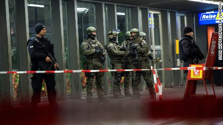 Police stand guard at a train station in Munich following threats of suicide bombings.