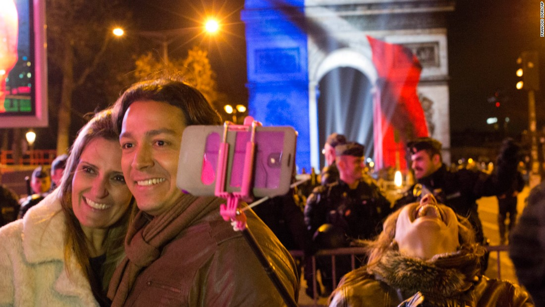 Party goers take selfies at the Arc de Triomphe during New Year's celebrations in Paris.