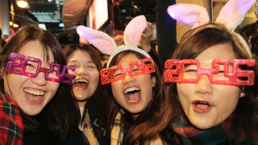 Revelers smile during the New Year's Eve celebrations in Hong Kong.