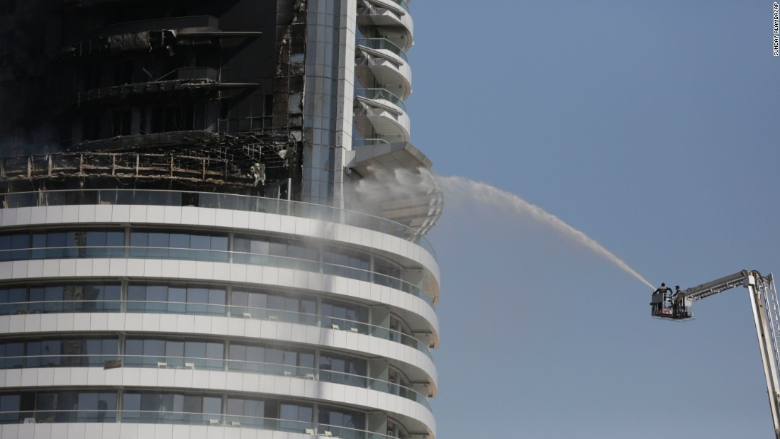 Firefighters continue to work at the Address hotel in downtown Dubai on Friday, January 1. A massive fire broke out Thursday night at the high-end hotel in the United Arab Emirates' most populous city.