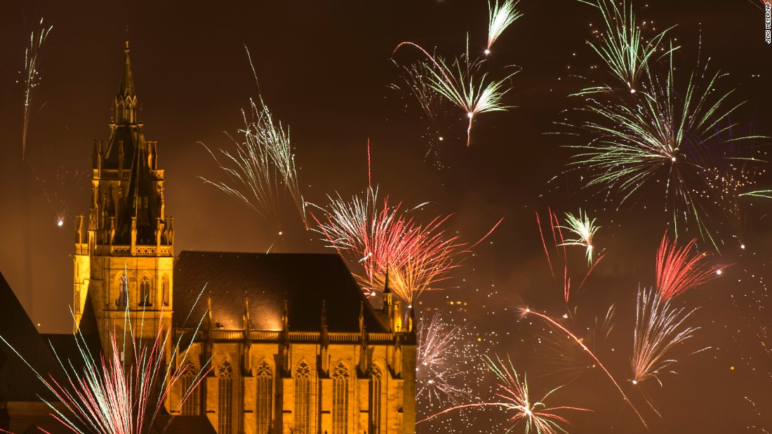 Fireworks explode over St. Mary's Cathedral in Erfurt, central Germany.