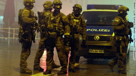 MUNICH, GERMANY - JANUARY 01:  Riot police armed with machine guns controls the street in front of Pasing railway station on January 1, 2016 in Munich, Germany. According to Joachim Herrmann, Bavarian Secretary of the Interior, there was intelligence for an IS terror attack planned for new Year's eve in in at least two Munich railway stations.  (Photo by Johannes Simon/Getty Images)