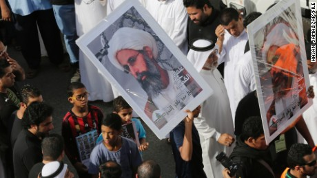 In this Saturday, May 30, 2015, photo, Saudis carry a poster demanding freedom for jailed Shiite cleric Sheikh Nimr al-Nimr, during a funeral procession, in Tarut, Saudi Arabia. Saudi Arabia says it has executed 47 prisoners, including leading Shiite cleric Sheikh Nimr al-Nimr. The clerics name was among a list of the 47 prisoners executed carried by the state-run Saudi Press Agency. It cited the Interior Ministry for the information.  (AP Photo/Hasan Jamali)