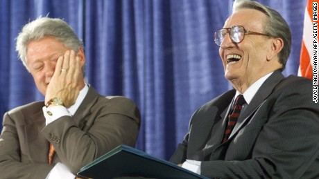 President Bill Clinton laughs with former U.S. Sen. Dale Bumpers, D-Arkansas, during the National Institutes of Health dedication ceremony of the Dale and Betty Bumpers Vaccine Research Center on June 9, 1999, in Bethesda, Maryland.