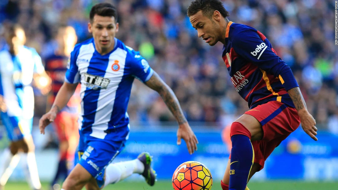 Barcelona's Brazilian forward Neymar (R) controls the ball past RCD Espanyol's Paraguayan midfielder Hernan Perez in what was a closely fought game.
