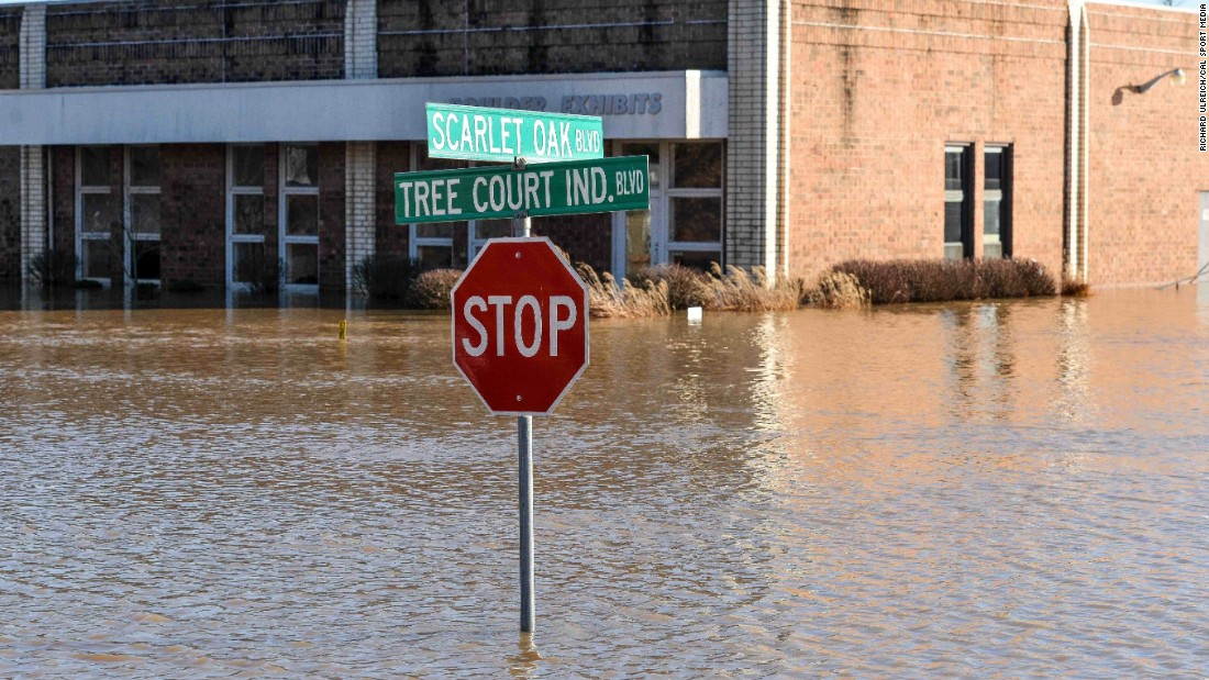 Buildings in the Tree Court Industrial Boulevard area of St. Louis remain flooded on January 1 after more than 10 inches of rain fell.