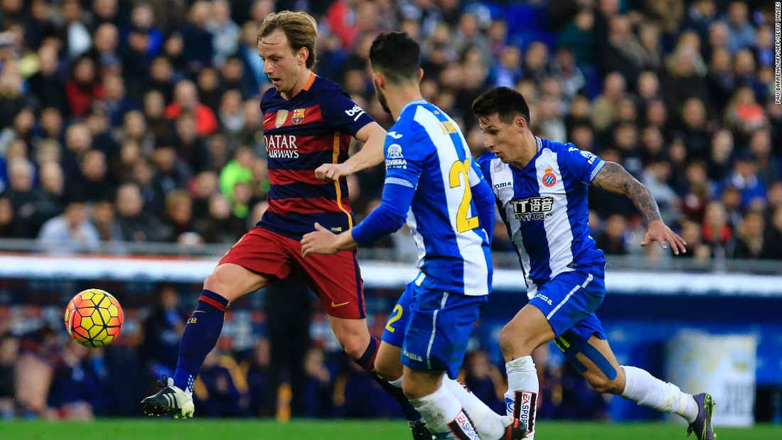 Barcelona's Croatian midfielder Ivan Rakitic (L) vies for possession with Espanyol's Spanish defender Alvaro Gonzalez.