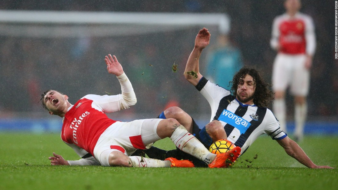 Aaron Ramsey and Fabricio Coloccini (R) compete for the ball in what was a keenly contested match.