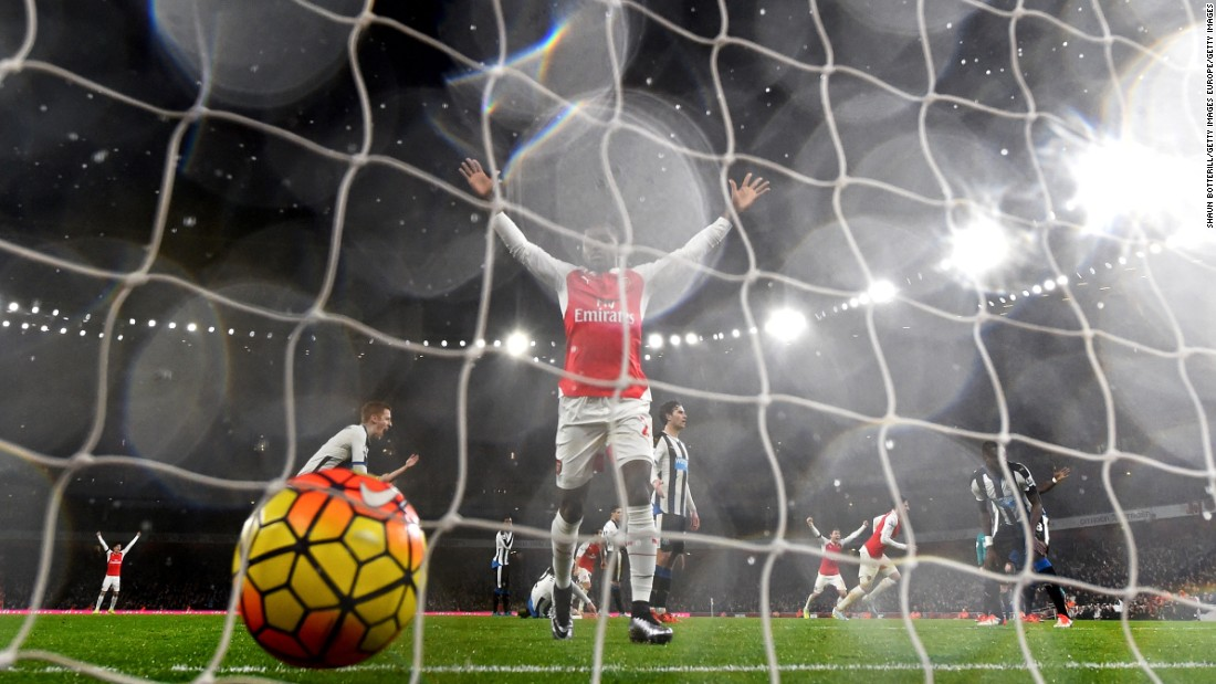 Joel Campbell of Arsenal celebrates after Koscielny opened the scoring.