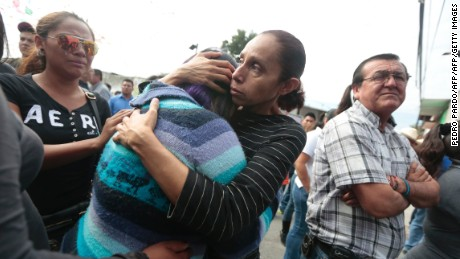 Local residents gather on January 2, 2016 outside the house of Gisela Mota, newly elected Mayor of Temixco, Morelos State, Mexico, murdered on Saturday at home by gunmen. AFP PHOTO/Pedro PARDO / AFP / Pedro PARDO        (Photo credit should read PEDRO PARDO/AFP/Getty Images)
