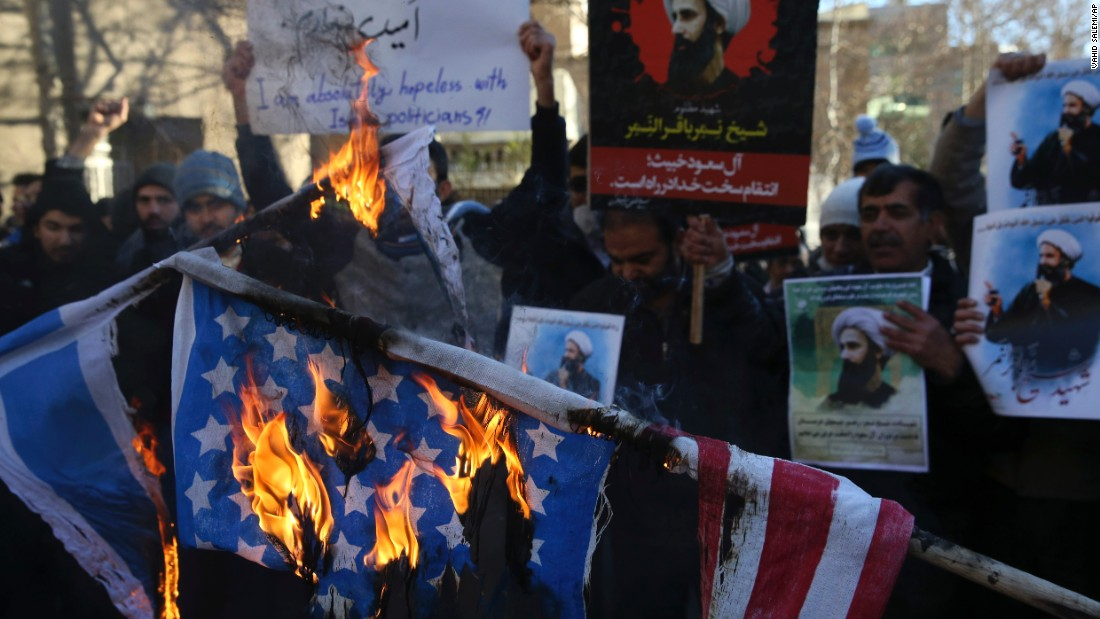 Iranian demonstrators burn representations of the U.S. and Israeli flags during a demonstration in front of the Saudi Arabian Embassy in Tehran on January 3.
