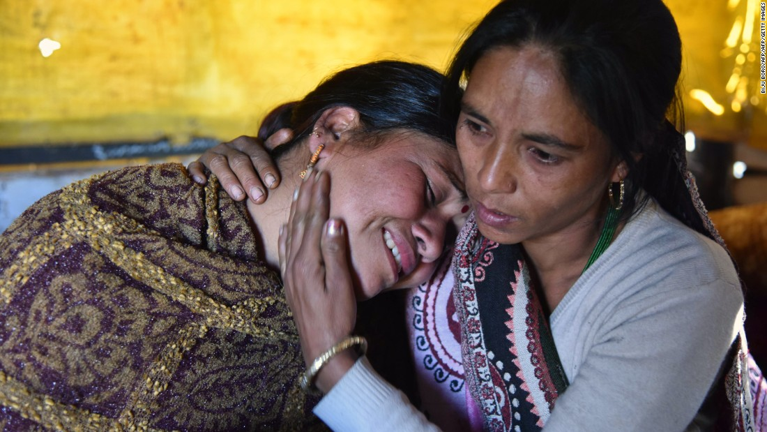 An woman in the Leimakhong village is consoled after her mother and niece were killed in the earthquake on January 4.