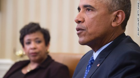 US President Barack Obama speaks with Attorney Genral Loretta Lynch in the Oval Office of the White House in Washington, DC, January 4, 2016.