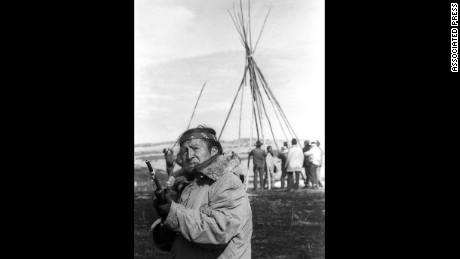 Oscar Bear Runner stands guard as members of the American Indian Movement set up a tepee south of Wounded Knee, South Dakota, on March 3, 1973.