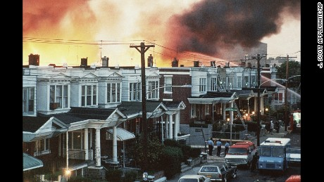 Flames shoot up skyward at the MOVE compound in West Philadelphia, Pennsylvania, on May 14, 1985.