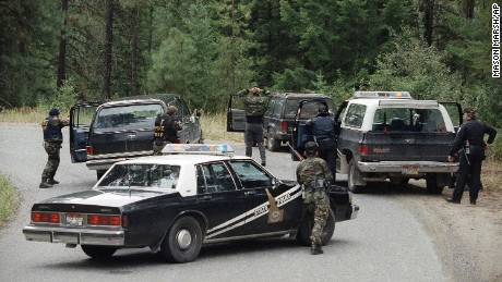 Agents place the first of five neo-Nazis under arrest near Naples, Idaho, on August 25, 1992. Weapons were found in the group's car near a police barricade three miles from the site of a standoff with Randy Weaver.