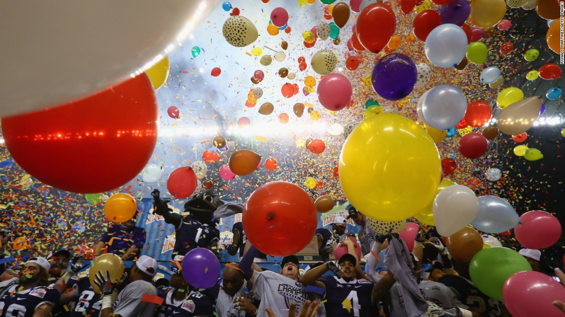 Balloons and confetti rain down on TCU's football team after its comeback victory in the Alamo Bowl on Saturday, January 2. The Horned Frogs trailed Oregon 31-0 at halftime but rallied for a 47-41 overtime victory. It tied the largest comeback ever in a bowl.