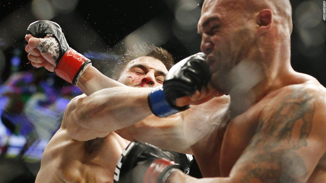 UFC fighter Carlos Condit, left, trades blows with Robbie Lawler during their welterweight title fight in Las Vegas on Saturday, January 2. Lawler retained his title by split decision.