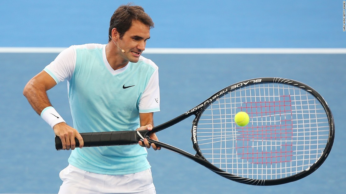 Roger Federer has some fun with an oversized racket during an exhibition event in Brisbane, Australia, on Sunday, January 3.