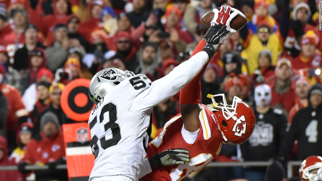 Kansas City tight end Demetrius Harris, right, pulls in a touchdown pass as he's defended by Oakland's Malcolm Smith on Sunday, January 3. It was the first touchdown of his NFL career, and Kansas City won the game 23-17.