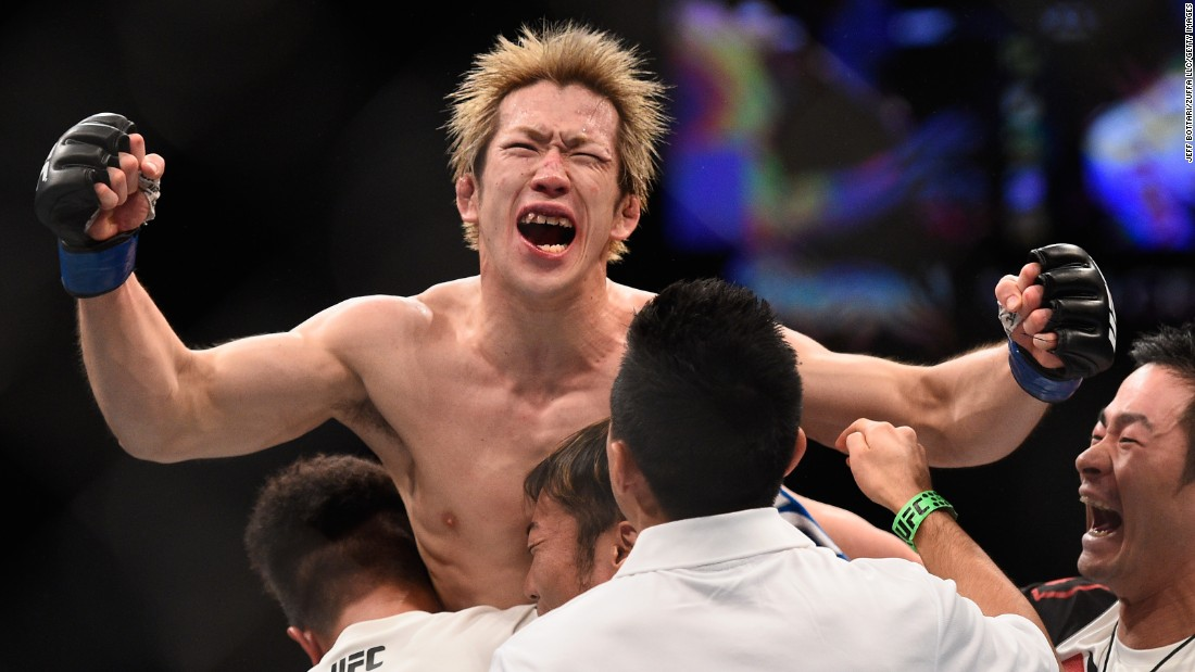 Michinori Tanaka reacts after winning a split decision over Joe Soto at UFC 195 on Saturday, January 2.