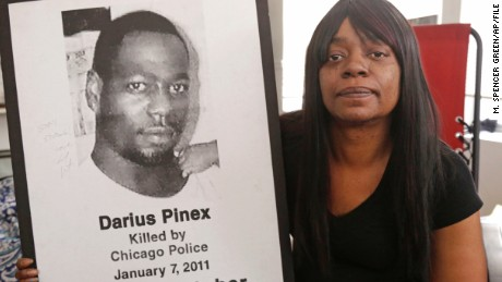 Gloria Pinex holds a photo of her son Darius Pinex at her home in Chicago. Darius, was killed by Chicago police in 2011.