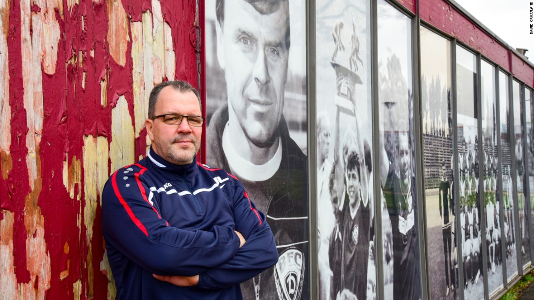 BFC manager Jörn Lenz, 46, a former midfielder for the club, stands next to photos of the team's past successes. BFC won East Germany's Oberliga for 10 successive years between 1979 and 1988.