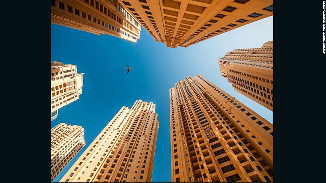 "A plane is spotted through the highrise buildings that have come to dominate Dubai in this photo posted by Mustafa Sheikh (<a href=""https://www.instagram.com/mustafa_sheikh/"" target=""_blank"">@mustafa_sheikh</a>)."