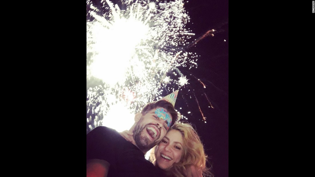 "Spanish soccer player Gerard Pique <a href=""https://www.instagram.com/p/_-XgLXNsCz/?taken-by=3gerardpique"" target=""_blank"">rings in the new year</a> with his wife, pop star Shakira, on Friday, January 1."