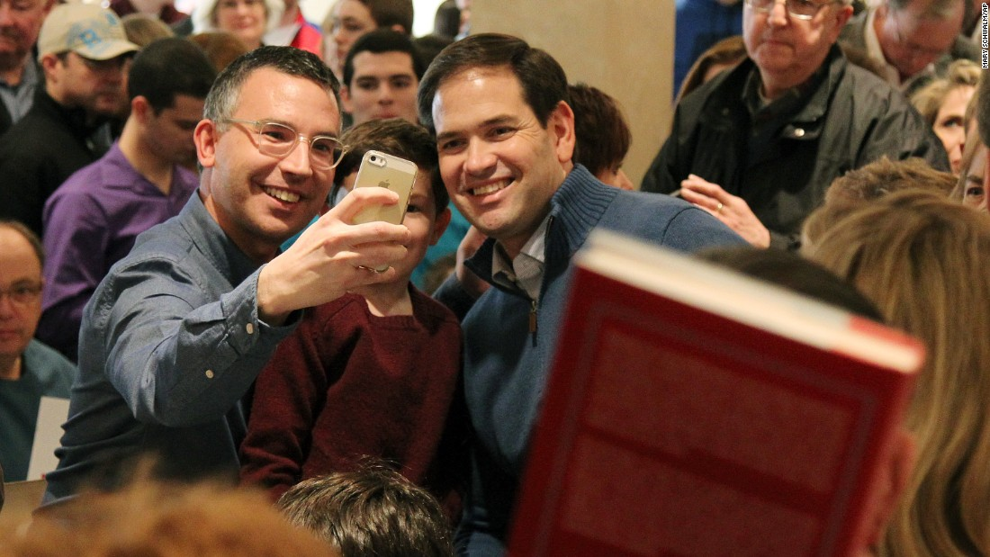 U.S. Sen. Marco Rubio, a Republican presidential candidate, poses for a supporter's selfie at a campaign stop in Atkinson, New Hampshire, on Sunday, January 3.
