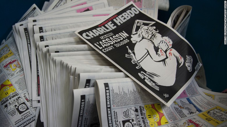 Charlie Hebdo comes out fighting after painful year