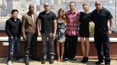 "TO GO WITH AFP STORY BY MAUREEN COFFLARDThe cast of the movie ""Fast and Furious 5"" (from left) director and producer Justin Lin, US actors Tyrese Gibson and Vin Diesel, Spanish actress Elsa Pataky, US actor Paul Walker, Israeli actress Gal Gadot and US actor Dwayne Johnson pose on April 28, 2011 in Marseille during a photocall. The movie will be released on French screens on May 04, 2011. AFP PHOTO / BORIS HORVAT (Photo credit should read BORIS HORVAT/AFP/Getty Images)"