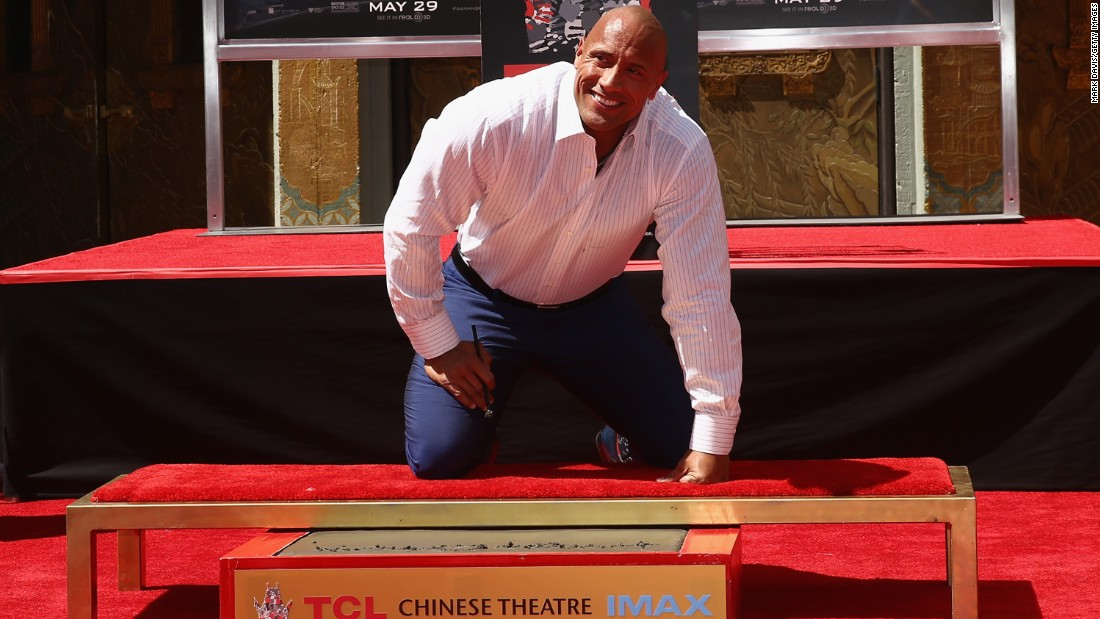 "Johnson's hand- and footprints were immortalized in concrete outside the TCL Chinese Theatre in Hollywood in the leadup to his summer 2015 disaster movie, ""San Andreas."" He thanked idol Steven Spielberg and signed the concrete, ""Blessed!"""