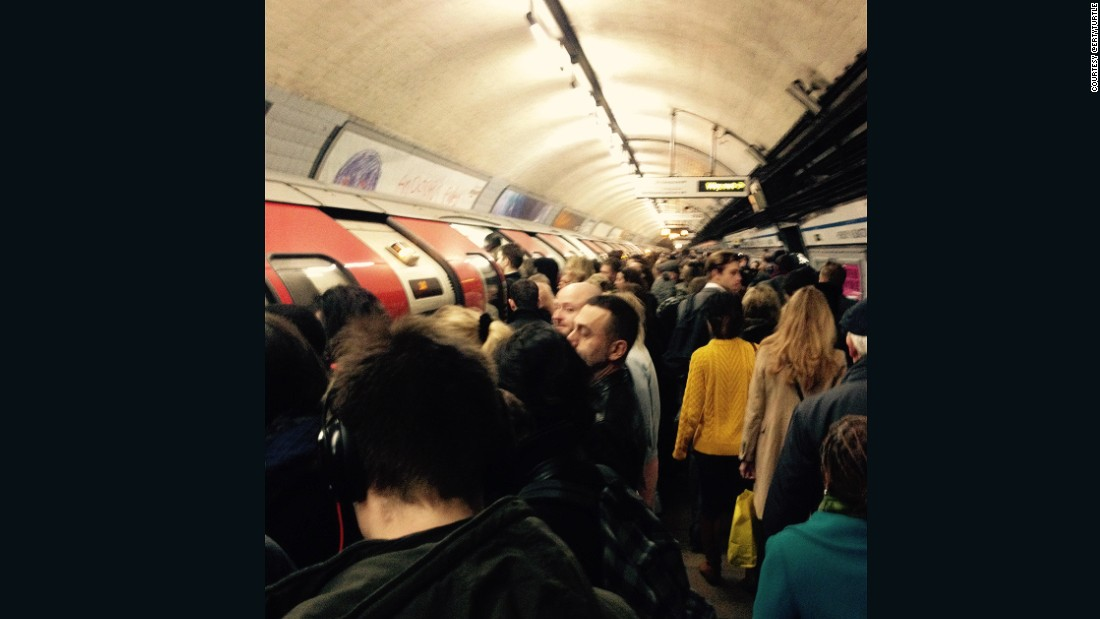 Commuters wait at a packed tube station in London in this image posted by CNN commenter ertyturtle, who wonders whether the English capital will ever stop growing.