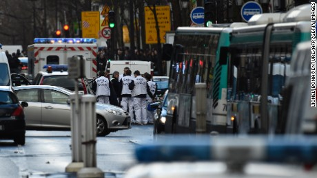 """Rescue workers are seen at the Boulevard de Barbes in the north of Paris on January 7, 2016, after police shot a man dead as he was trying to enter a police station in the Rue de la Goutte d'Or. The man shot dead by police on the first anniversary of the jihadist assault on Charlie Hebdo had a knife and what appeared to be an explosives vest, the government said. The man was also heard to shout """"Allahu Akbar"""" as he approached the police station in the multi-ethnic neighbourhood in the north of the capital, the interior ministry said. AFP PHOTO / LIONEL BONAVENTURE / AFP / LIONEL BONAVENTURE        (Photo credit should read LIONEL BONAVENTURE/AFP/Getty Images)"""