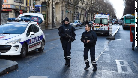 "Armed French police women are seen at Barbes-Rochechouart in the north of Paris on January 7, 2016, after police shot a man dead as he was trying to enter a police station. A witness told AFP he had heard ""two or three shots"" in the incident that occurred a year to the day of the jihadist attack on satirical newspaper Charlie Hebdo.  AFP PHOTO / LIONEL BONAVENTURE / AFP / LIONEL BONAVENTURE        (Photo credit should read LIONEL BONAVENTURE/AFP/Getty Images)"