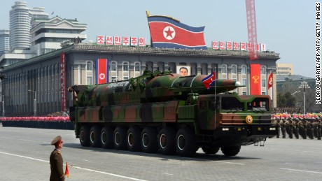 A military vehicle carries what is believed to be a Taepodong-class missile Intermediary Range Ballistic Missile (IRBM), about 20 meters long, during a military parade to mark the 100 birth of the country's founder Kim Il-Sung in Pyongyang on April 15, 2012. The commemorations came just two days after a satellite launch timed to mark the centenary fizzled out embarrassingly when the rocket apparently exploded within minutes of blastoff and plunged into the sea.    AFP PHOTO / PEDRO UGARTE (Photo credit should read PEDRO UGARTE/AFP/Getty Images)