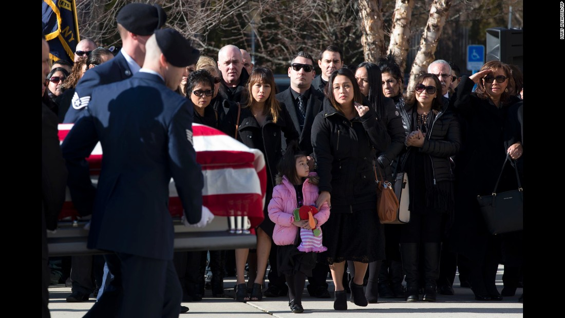 "The casket of Air Force Staff Sgt. Louis Bonacasa is carried past his wife, Deborah, and his 5-year-old daughter, Lilianna, during his funeral service in Coram, New York, on Saturday, January 2. Bonacasa was one of six Americans <a href=""http://www.cnn.com/2015/12/22/asia/nato-members-killed-bagram-afghanistan/"" target=""_blank"">killed in a suicide attack in Afghanistan.</a>"