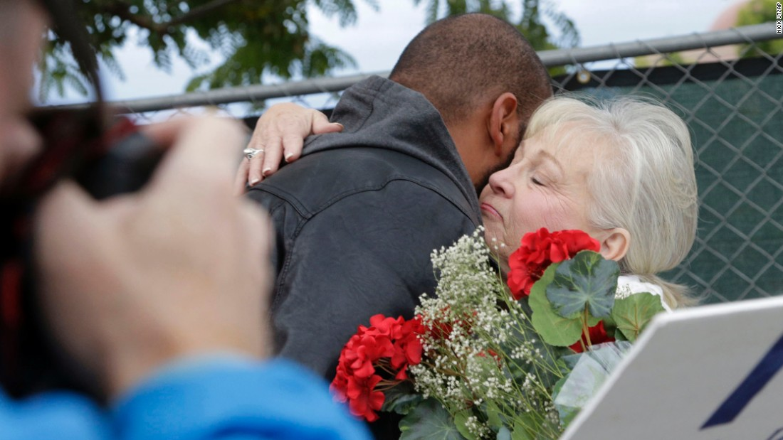 "Employees of the Inland Regional Center hug before returning to work Monday, January 4, in San Bernardino, California. The building was the site of <a href=""http://www.cnn.com/2015/12/02/us/gallery/san-bernardino-shooting/index.html"" target=""_blank"">a mass shooting</a> that killed 14 people and injured 21 in December."